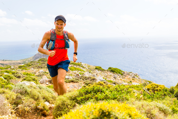 Mountain running man in inspirational landscape - Stock Photo - Images