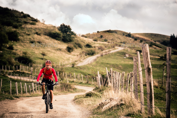 Mountain biker riding MTB - Stock Photo - Images