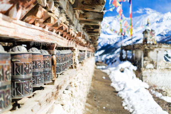 Prayer wheels in high Himalaya Mountains, Nepal village - Stock Photo - Images