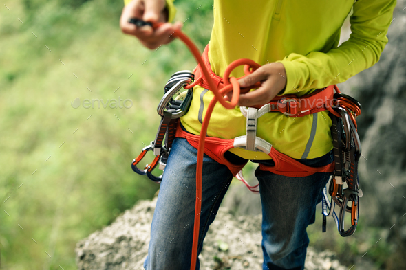 Making an eight knot before climbing  - Stock Photo - Images