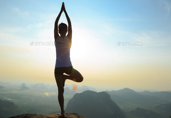 Yoga in the sunrise - Stock Photo - Images