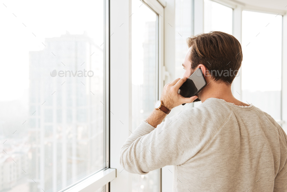 Photo from back of caucasian man with short brown hair looking t - Stock Photo - Images