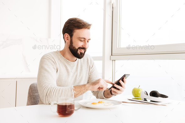 Portrait of positive unshaved man in casual shirt having healthy - Stock Photo - Images