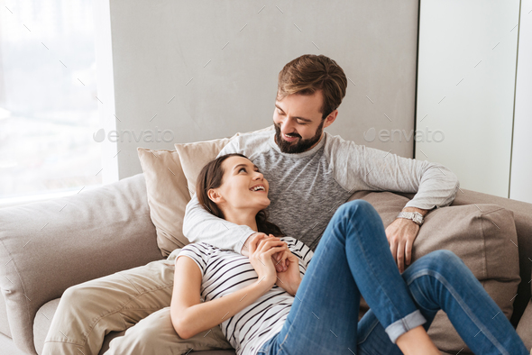 Portrait of a smiling young couple together - Stock Photo - Images