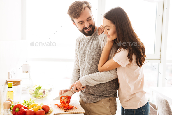 Portrait of a pretty young couple - Stock Photo - Images