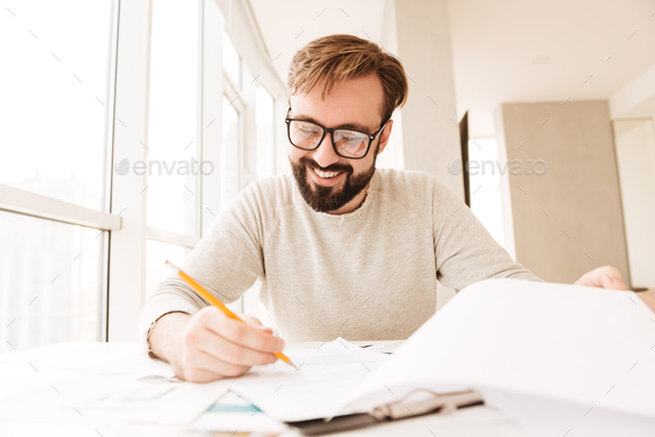 Portrait of a happy man working with documents - Stock Photo - Images