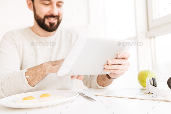 Photo of blurry adult man in modern hotel room having healthy me - Stock Photo - Images