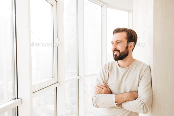 Handsome guy 30s having beard and mustache, smiling and looking - Stock Photo - Images