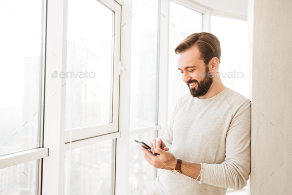 Photo of relaxed guy 30s having beard and mustache, spending tim - Stock Photo - Images