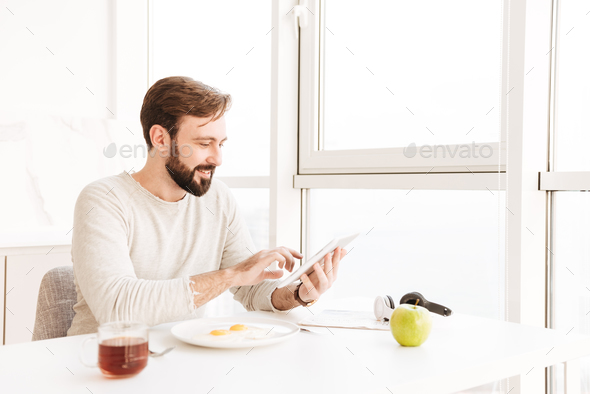 Portrait of healthy adult man in casual shirt smiling and having - Stock Photo - Images