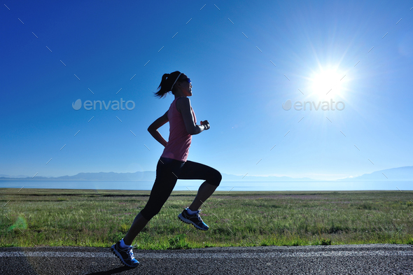 Running in sunrise mountain trail - Stock Photo - Images