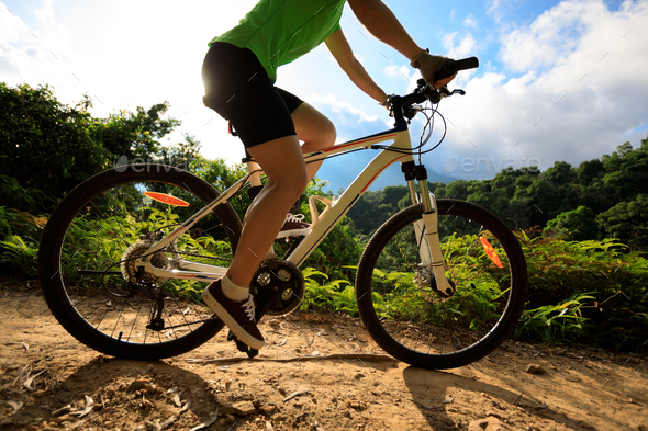 Cycling on Summer sunrise mountain trail - Stock Photo - Images