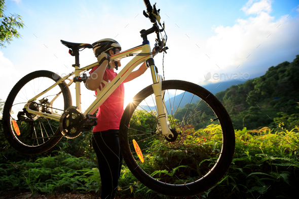 Cyclist with mountain bike in sunrise mountains - Stock Photo - Images