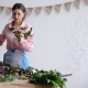 Concentrated Young Female Florist Creating a Floral Composition, Inspect Flowers - VideoHive Item for Sale