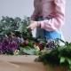 A Florist Composes a Large Eucalyptus Branch for a Bouquet - VideoHive Item for Sale