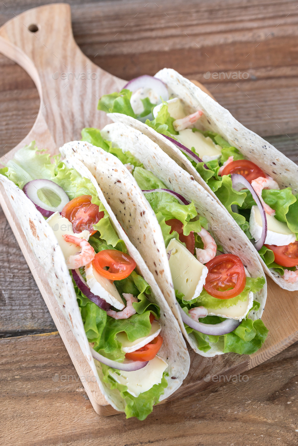 Tacos with shrimps, brie and fresh vegetables - Stock Photo - Images