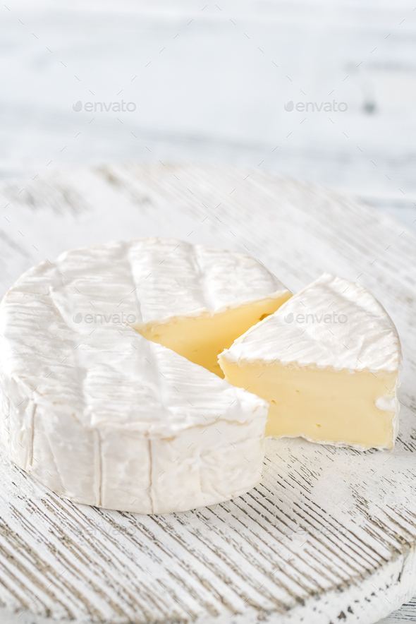Camembert cheese on the wooden board - Stock Photo - Images