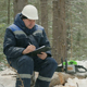 Worker With Tablet Working in Winter Forest - VideoHive Item for Sale