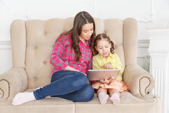 Young mother teaches a child with a tablet - Stock Photo - Images