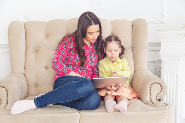 Mother with children learning computer tablet - Stock Photo - Images