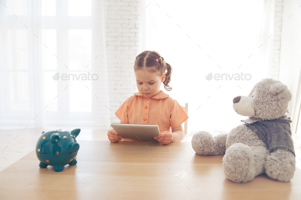 Child using a tablet at home. - Stock Photo - Images