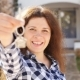 Happy Young Woman In Front of New Home with Keys - VideoHive Item for Sale