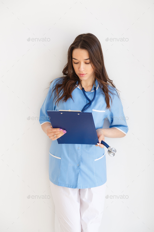 Young female doctor with the patient's story. - Stock Photo - Images
