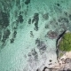 Aerial View of a Beautiful Tropical Bay at Tropical Island with Rocks, Cape and Jungle. Waves Break - VideoHive Item for Sale