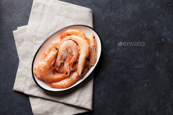 Fresh seafood on stone table. Shrimps - Stock Photo - Images
