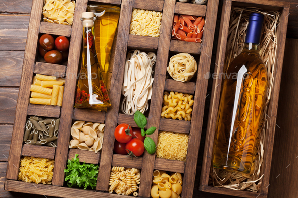 Various pasta in wooden box and wine - Stock Photo - Images