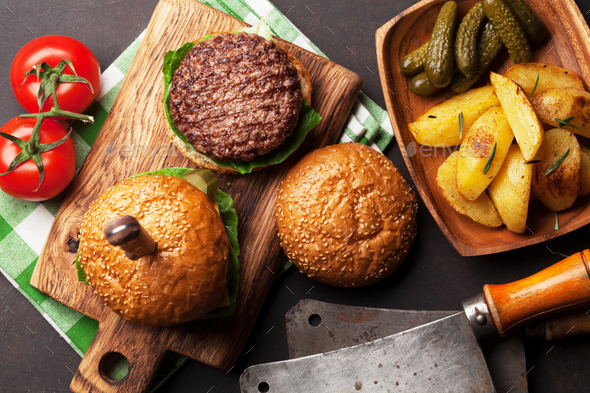 Tasty grilled home made burgers - Stock Photo - Images
