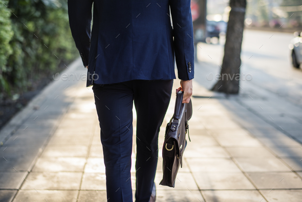 Business man on the go to work - Stock Photo - Images