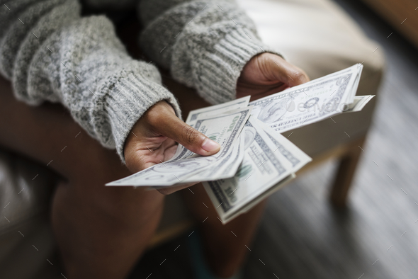 Closeup of woman counting money - Stock Photo - Images