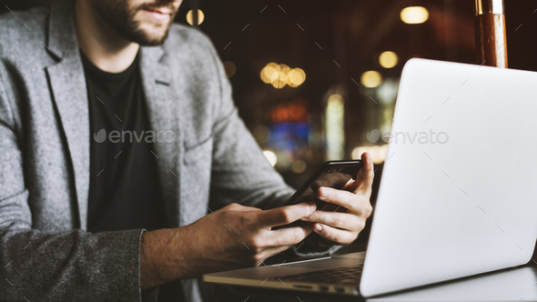 Casual man using mobile phone in a cafe - Stock Photo - Images