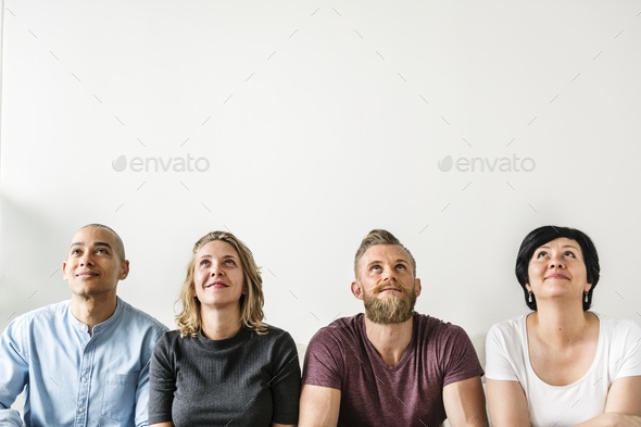 Diverse people sitting with thoughtful face expression - Stock Photo - Images