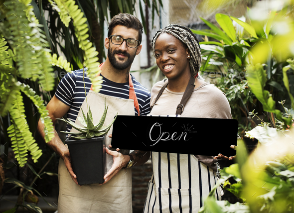 """People holding an """"open"""" sign - Stock Photo - Images"""