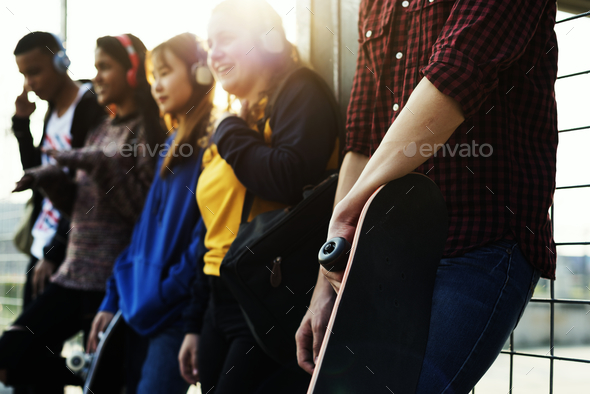 Group of school friends outdoors lifestyle and music leisure concept - Stock Photo - Images