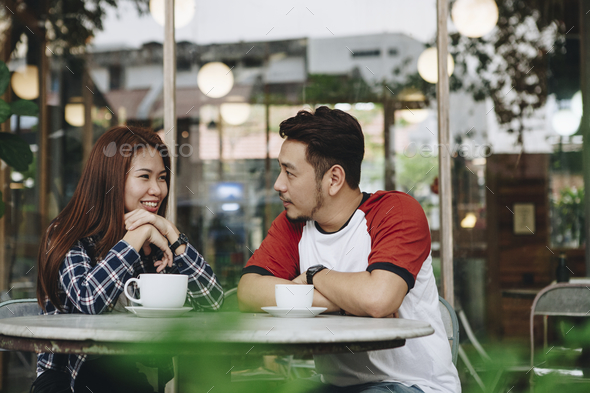 Couple enjoying a hot drink - Stock Photo - Images