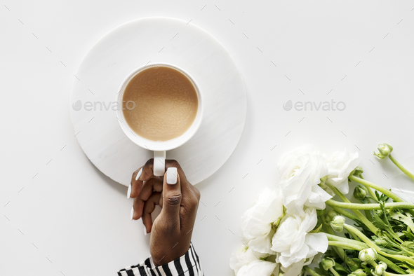 Aerial view of black woman drinks coffee - Stock Photo - Images