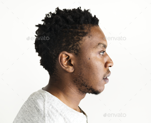 African ethnicity man portrait shoot in a studio - Stock Photo - Images