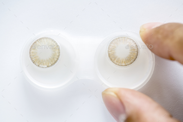 Closeup of colored contact lens in case - Stock Photo - Images