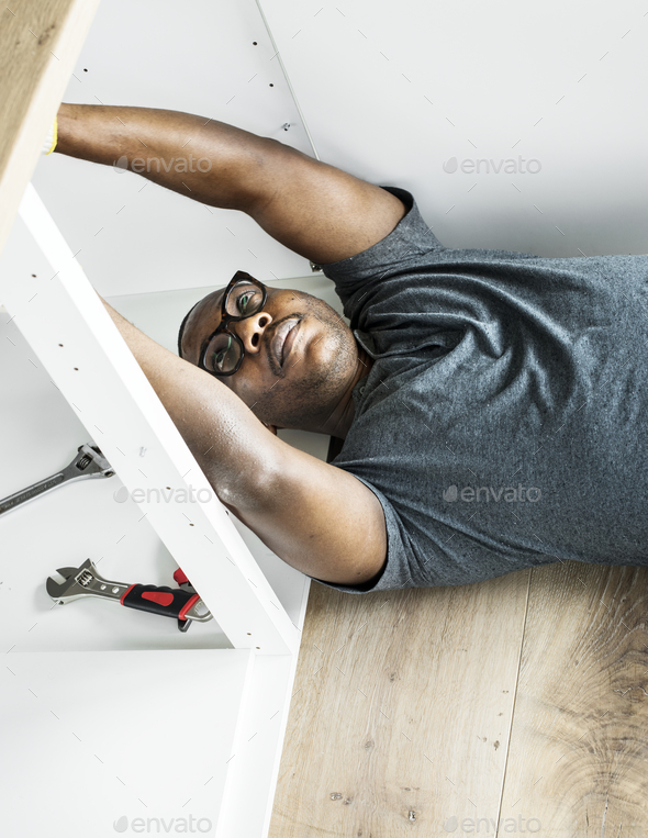 Plumber man fixing kitchen sink - Stock Photo - Images