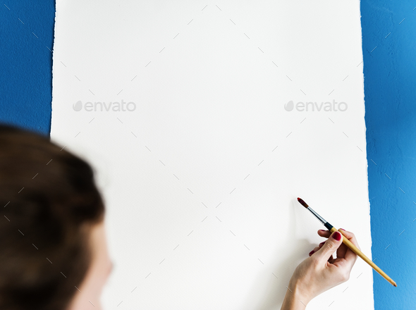 Painter start drawing on a blank canvas - Stock Photo - Images