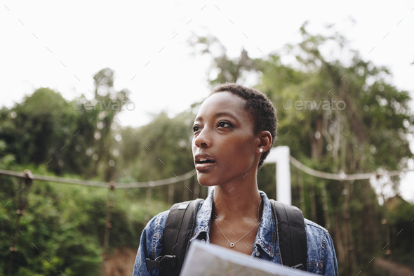 African American woman looking at a map travel and explore concept - Stock Photo - Images
