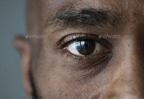 Closeup of an eye of a black man - Stock Photo - Images