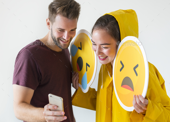 Couple taking selfie with emojis - Stock Photo - Images