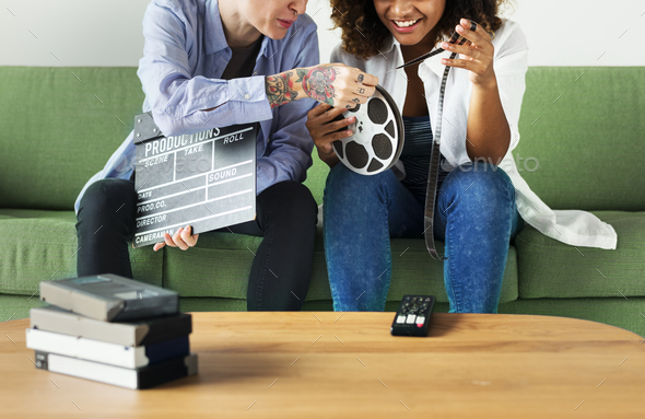 Young women with movie film reel - Stock Photo - Images