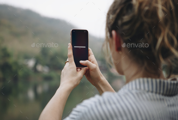 Woman searching for signal with her mobile phone - Stock Photo - Images