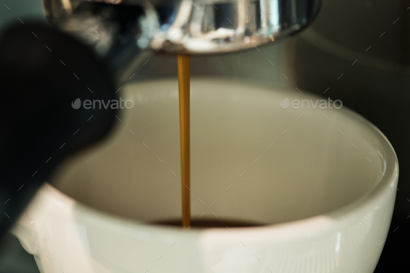 Closeup of coffee machine making espresso drink - Stock Photo - Images