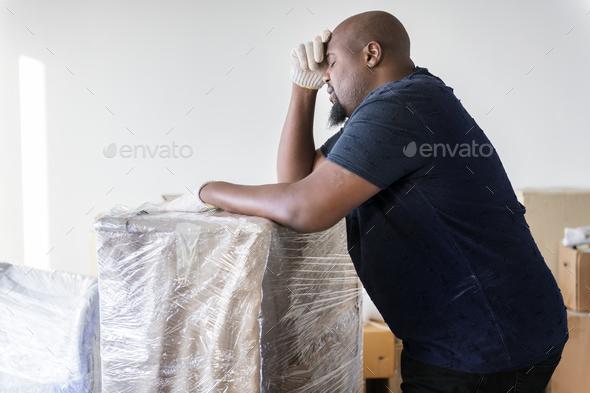 Black man moving furniture - Stock Photo - Images